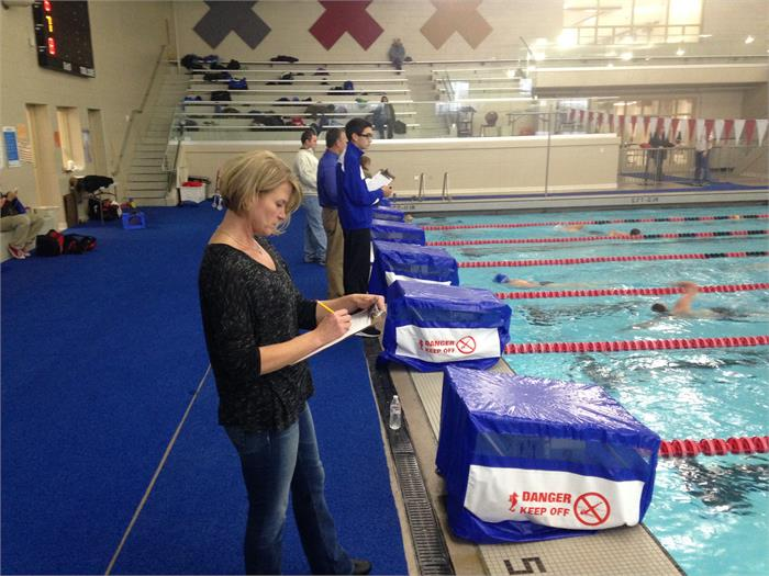 Parents record laps during the Swim-A-Thon