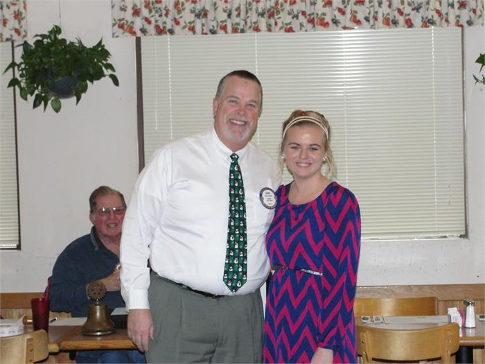 Rotarian Dave Kindell and November Student of the Month, Caitlin Perry.