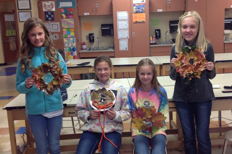 Students in STEAM display their fall wreaths