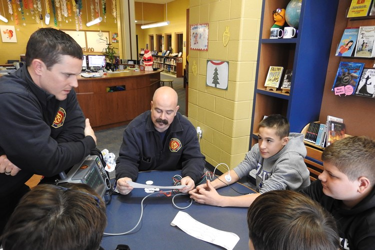 BIS Science Cafe learns about E.K.G.s from Brookville's Emergency Medical Service members.