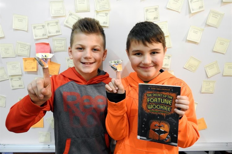 Two students presenting their favorite book.