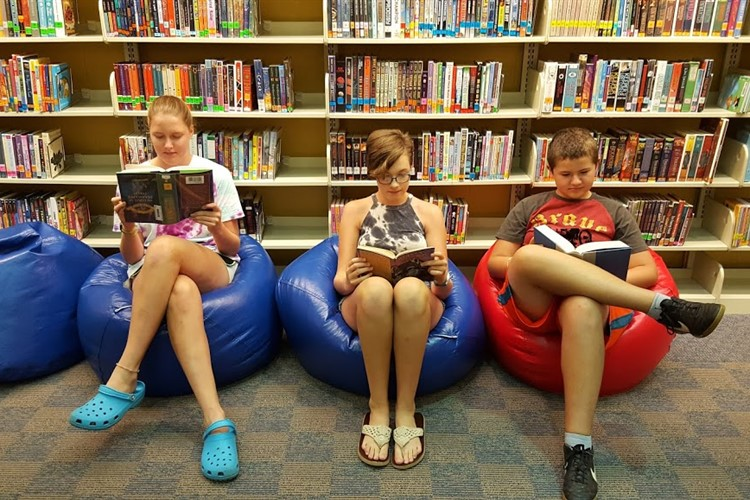 Students reading on bean bags