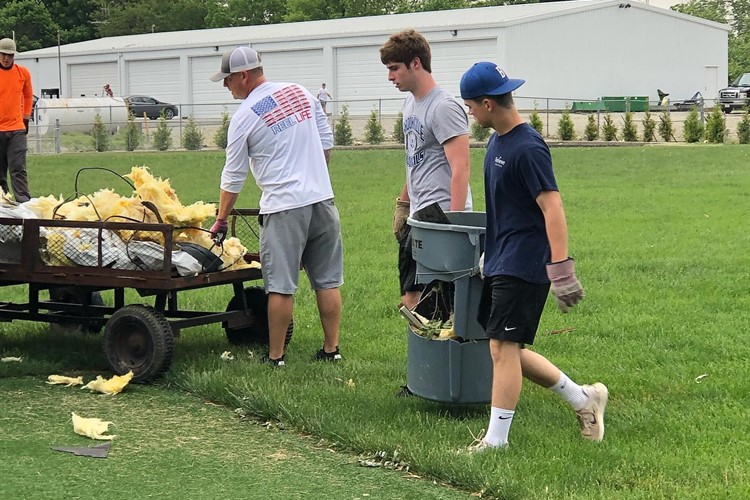Athletes Clean up Debris At Stadium