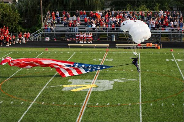 Flag & Game Ball Delivered via Sky Divers