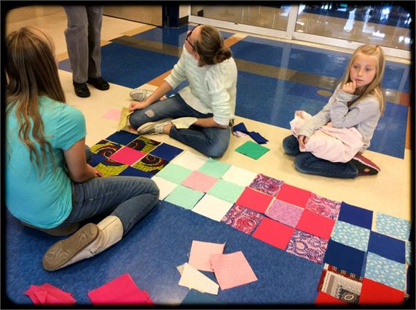 Key Club members learn how to quilt to help others in need